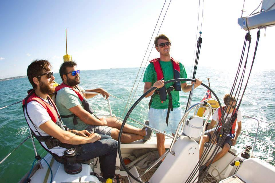 Students receiving sailing tuition on a yacht in Jersey