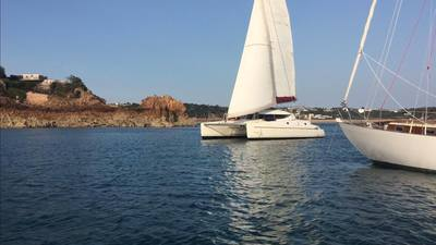 Sailing into Beauport Bay, Jersey, aboard Fontaine Pajot Athena 38  catamaran