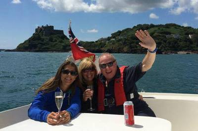 Enjoy a drink whilst sailing past Gorey castle in Jersey