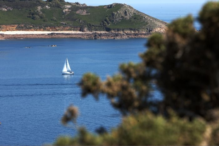 Sailing in Jersey in one of our sandy bays with blue water