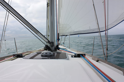 Genoa on a Dufour 34 Perfomance under sail on Sailing Skills course