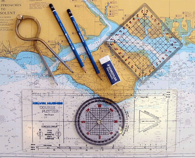 Charts, portland plotter, dividers used on RYA Sailing course