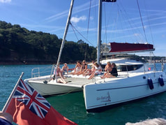 Party aboard our Fontaine Pajot catamaran sailing along the Jersey Coastline